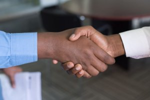 two people shaking hands after reaching an agreement