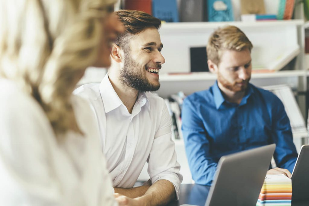 |how to found a startup|a team of professionals working together on their computers|how to write a business plan|how to found a startup