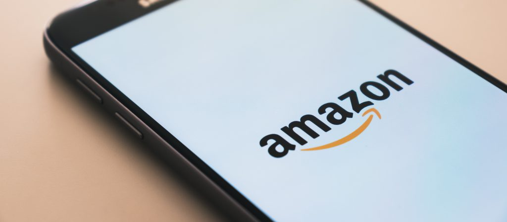"""Why Your Business Needs an Amazon Business Account several phones with the word """"amazon"""" on them colorful shopping cart animation           Why Your Business Needs an Amazon Business Account """