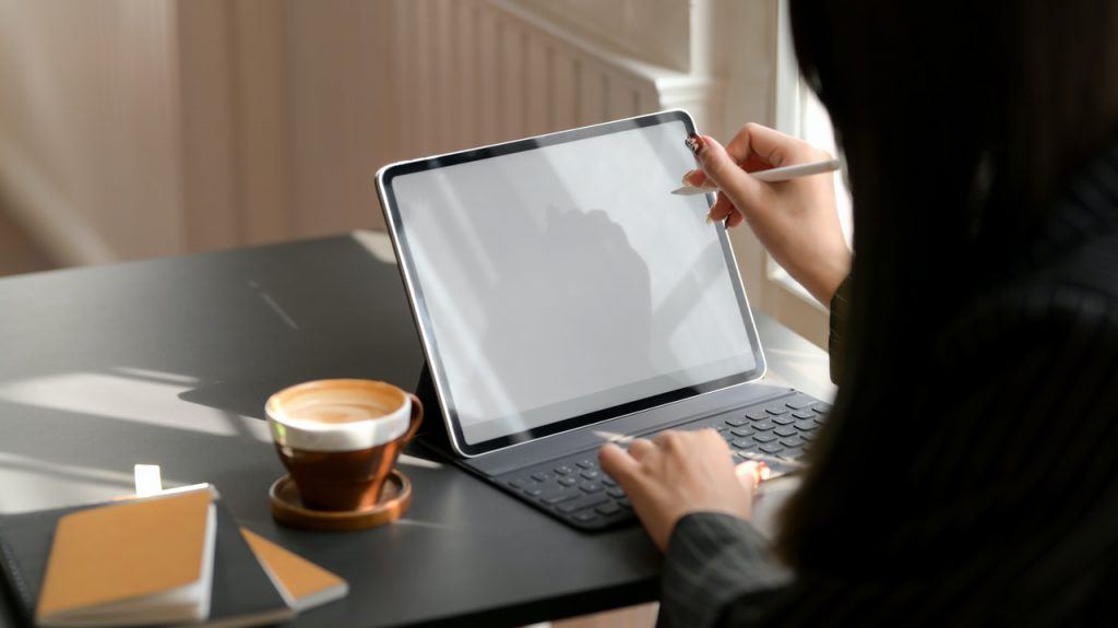 person-using-tablet-computer-with-keyboard